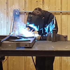 Welder welding, metal fabrication